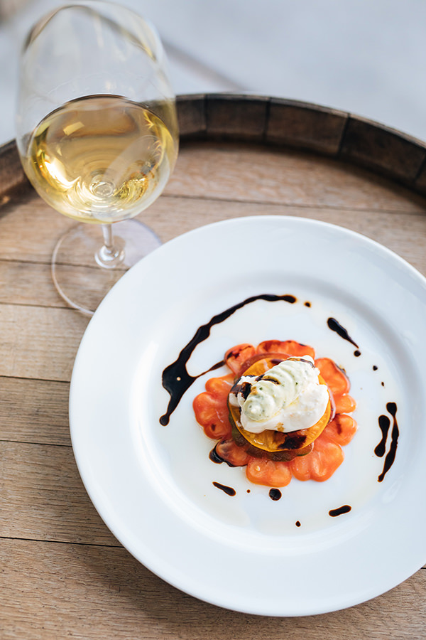 white wine in a glass paired with a plated dessert