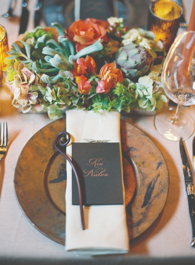 dining room place setting with flower arrangement
