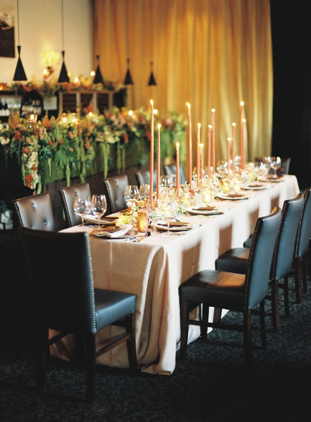 dining table with candles and place settings
