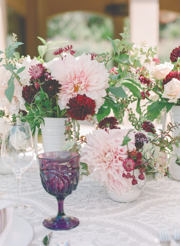 pink and red flower arrangements with purple glass
